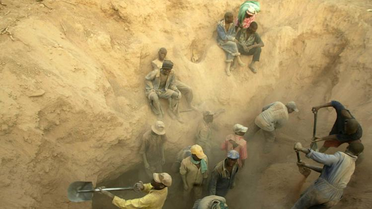 "FILE -- In this Wednesday, Nov. 1, 2006 file photo  miners dig for diamonds - Miners dig for diamonds in Marange, Zimbabwe At least $2 billion worth of diamonds have been stolen from Zimbabwe's eastern diamond fields and have enriched President Robert Mugabe's ruling circle, international gem dealers and criminals, according to an organization leading the campaign against conflict diamonds. Zimbabwe's Marange fields have seen ""the biggest plunder of diamonds since Cecil Rhodes,"" the colonial magnate who exploited South Africa's Kimberley diamonds a century ago, charged Partnership Africa Canada, a member of the Kimberley Process, the world regulatory body on the diamond trade.  (AP Photo/Tsvangirayi Mukwazhi-File)"