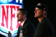 "Baltimore Ravens coach John Harbaugh (L) and San Francisco 49ers coach Jim Harbaugh at a press conference in New Orleans on February 1, 2013. ""Everybody in America understands Katrina and New Orleans,"" John said"