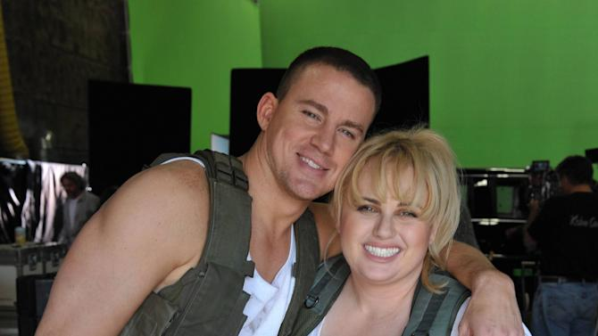 "IMAGE DISTRIBUTED FOR MTV NETWORKS - In this images released on Friday March 15, 2013, host Rebel Wilson, right, and Channing Tatum are seen behind the scenes on set at the ""2013 MTV Movie Awards"" on-air promo shoot in Los Angeles. (Photo by John Shearer/Invision for MTV/AP Images)"