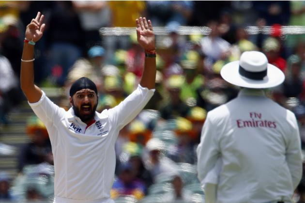 England's Panesar appeals unsuccessfully for leg before wicket against Australia's Rogers during the second Ashes test cricket match in Adelaide
