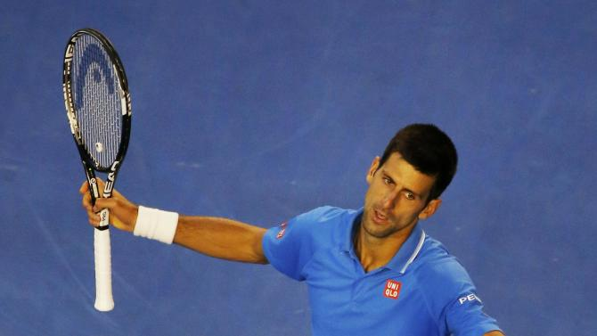 Djokovic of Serbia reacts after hitting a return to Wawrinka of Switzerland during their men's singles semi-final match at the Australian Open 2015 tennis tournament in Melbourne