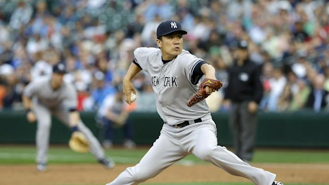 New York Yankees starting pitcher Masahiro Tanaka throws against the Seattle Mariners in the first inning of a baseball game on Wednesday, June 11, 2014 in Seattle. (AP Photo/Ted S. Warren)