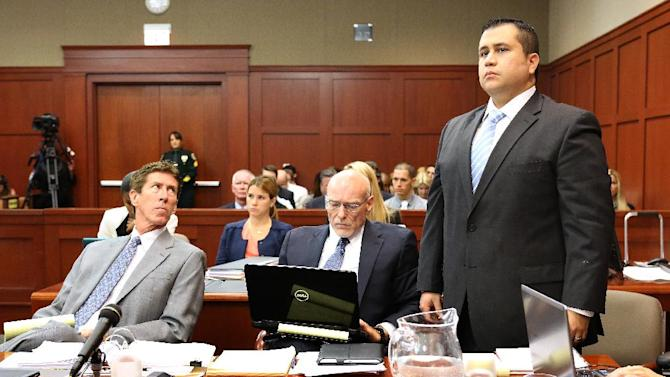 George Zimmerman, right, stands up at the defense table with his attorneys, Mark O'Mara, left, and Don West, center, as he is identified by state witness Doris Singleton, a Sanford police officer, during her testimony in Zimmerman's trial in Seminole circuit court, in Sanford, Fla., Monday, July 1, 2013. Zimmerman has been charged with second-degree murder for the 2012 shooting death of Trayvon Martin.(AP Photo/Orlando Sentinel, Joe Burbank, Pool)