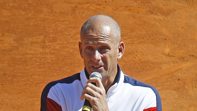 French team coach Guy Forget is overcome by emotion as he thanks the public after French  player Jo-Wilfried Tsonga was defeated by U.S. players John Isner, in the quarterfinal of the Davis Cup between France and U.S. in Monaco Sunday April 8, 2012.(AP Photo/Remy de la Mauviniere)