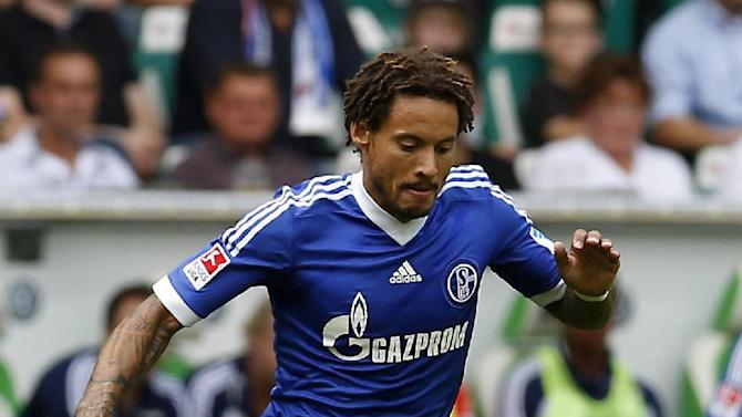 """In this picture taken Aug. 17, 2013 Schalke's Jermaine Jones of the U.S. plays the ball during the German first division Bundesliga soccer match between VfL Wolfsburg and FC Schalke 04 in Wolfsburg, Germany. US midfielder Jones is joining Turkish club Besiktas on loan from Bundesliga team Schalke until the end of the season, with an option to make the move permanent. Besiktas announced the deal Thursday, Jan. 30, 2014 and Schalke general manager Horst Heldt says the 32-year-old Jones will now get more opportunities to """"lay the foundations for a successful World Cup in Brazil."""" (AP Photo/Michael Sohn)"""