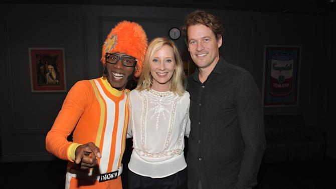 From left, DJ Lance Rock, Anne Heche and Coley Laffoon attend Yo Gabba Gabba! Live!: Get The Sillies Out! 50+ city tour kick-off performance on Thanksgiving weekend at Nokia Theatre L.A. Live on Friday Nov. 23, 2012 in Los Angeles. (Photo by John Shearer/Invision for GabbaCaDabra, LLC./AP Images)