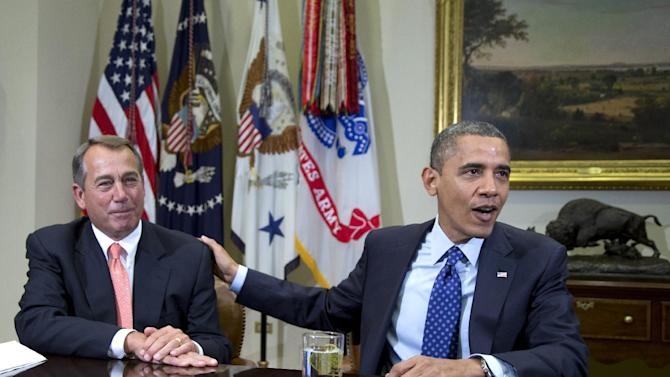 "FILE - In this Nov. 16, 2012, file photo, President Barack Obama acknowledges House Speaker John Boehner of Ohio while speaking to reporters in the Roosevelt Room of the White House in Washington, as he hosted a meeting of the bipartisan, bicameral leadership of Congress to discuss the deficit and economy. The 63-year-old speaker has been caught up ever since in a monumental struggle over taxes and spending aimed at keeping the country from taking a yearend dive over the ""fiscal cliff."" Obama is tugging Boehner one way in pursuit of a budget deal, while conservatives yank the other way, some howling that the speaker already is going wobbly on them and turning vindictive against those in his party who dare disagree. (AP Photo/Carolyn Kaster, File)"