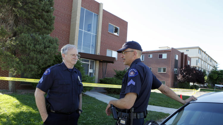 Aurora police officers Gary Reno, left, and Douglas Kasten stand guard at the apartment complex of shooting suspect James Eagen Holmes in Aurora, Colo. on Sunday, July 22, 2012. Holmes has been charged in the shooting at an Aurora theatre early Friday that killed twelve people and injured more than 50. (AP Photo/Ed Andrieski)