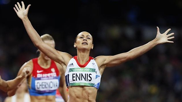 Britain's Jessica Ennis raises her arms as she wins her women's heptathlon 800m heat at the London 2012 Olympic Games at the Olympic Stadium (Reuters)