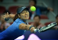 Li Na of China reaches for a backhand during her quarter final women's singles match against Agnieszka Radwanska of Poland at the China Open tennis tournament in the National Tennis Center of Beijing on October 5. Li went on to win 6-4, 6-2, setting up a testing semi-final with Maria Sharapova
