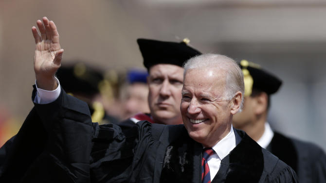 Vice President Joe Biden waves as he walks onto the field before giving the commencement address ar the University of Pennsylvania's 257th Commencement, Monday, May 13, 2013, in Philadelphia. (AP Photo/Matt Rourke)