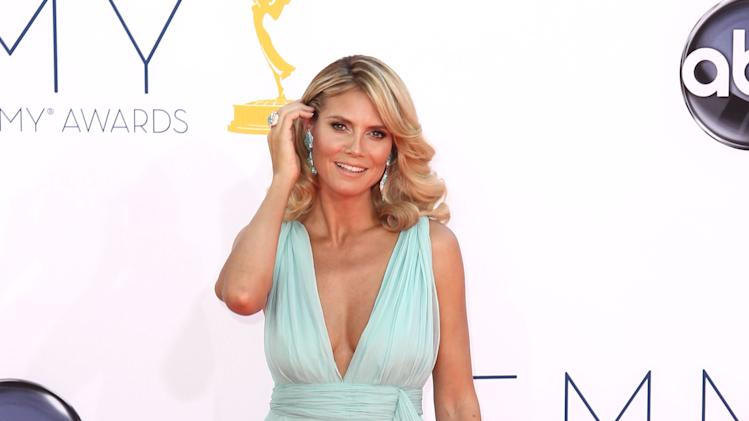Heidi Klum arrives at the 64th Primetime Emmy Awards at the Nokia Theatre on Sunday, Sept. 23, 2012, in Los Angeles. (Photo by Matt Sayles/Invision/AP)