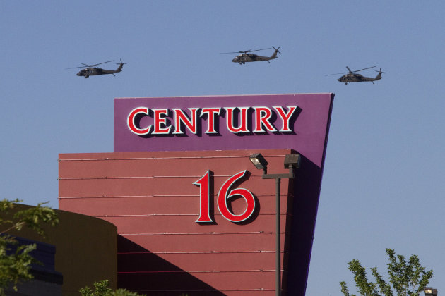 Three helicopters make a flyover of the Century Theater on Saturday, July 21, 2012 in Aurora, Colo. Twelve people were killed and dozenswere injured in the attack early Friday at the packed theater du