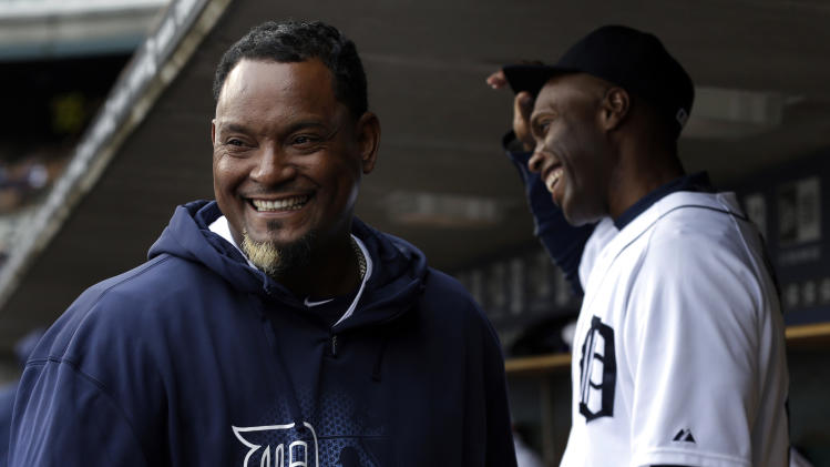 Detroit Tigers relief pitcher Jose Valverde, left, laughs with Torii Hunter in the dugout before a baseball game against the Kansas City Royals in Detroit, Wednesday, April 24, 2013. (AP Photo/Paul Sancya)