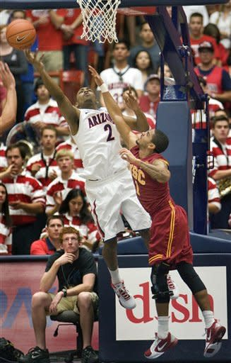 No. 6 Arizona rebounds from loss to rout USC 74-50