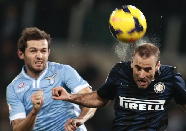 Inter Milan's Rodrigo Palacio and Lazio's Senad Lulic jump for the ball during their Italian Serie A soccer match at the Olympic stadium in Rome