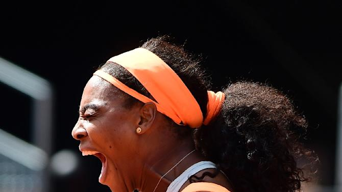 US tennis player Serena Williams celebrates her victory over Belarus tennis player Victoria Azarenka during the Madrid Open tournament at the Caja Magica (Magic Box) sports complex in Madrid on May 6, 2015