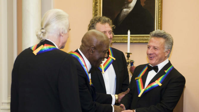 2012 Kennedy Center Honoree Buddy Guy, second from left, congratulates fellow honoree Dustin Hoffman, right, after the State Department Dinner for the Kennedy Center Honors gala Saturday, Dec. 1, 2012 at the State Department in Washington. Photographed with Guy and Hoffman are fellow honorees Jimmy Page, left, and Robert Plant. (AP Photo/Kevin Wolf)