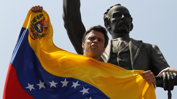 Venezuelan opposition leader Leopoldo Lopez speaks to supporters before handing himself over in Caracas