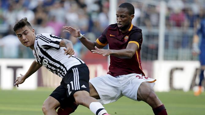 AS Roma's Keita and Juventus' Dybala fight for the ball during their Serie A soccer match at Olympic stadium in Rome