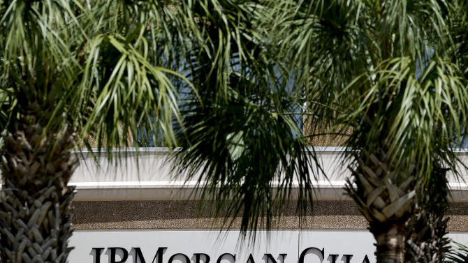 The front of one of the JPMorgan Chase & Co. buildings is shown during the annual meeting Tuesday, May 21, 2013, in Tampa, Fla. It's a pivotal day for Jamie Dimon, head of the country's biggest bank, his shareholders will vote whether to strip him of his role as bank chairman. (AP Photo/Chris O'Meara)