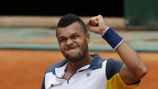 France's Jo-Wilfried Tsonga clenches his fist after defeating Slovenia's Aljaz Bedene during their first round match of the French Open tennis tournament at the Roland Garros stadium Monday, May 27, 2013 in Paris. Tsonga won 6-2, 6-2, 6-3. (AP Photo/Michel Spingler)