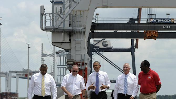 President Barack Obama, center, gets a tour of the Jacksonville, Fla. port with, from left, Transportation Secretary Anthony Foxx; Dennis Kelly, TracPac Regional Vice President and General Manager; Ray Schleicher, CEO of the Jacksonville Port Authority, and Fred Wakefield, International Longshoreman's Association Representative, during a tour, Thursday, July 25, 2013. A day after he kicked off the tour in Illinois and Missouri, Obama was traveling Thursday to a seaport in Jacksonville, Fla., to yet again deride the wide gulf between his vision for a new American prosperity driven by a burgeoning middle class and the intense gridlock snarling up Congress. (AP Photo/Susan Walsh)