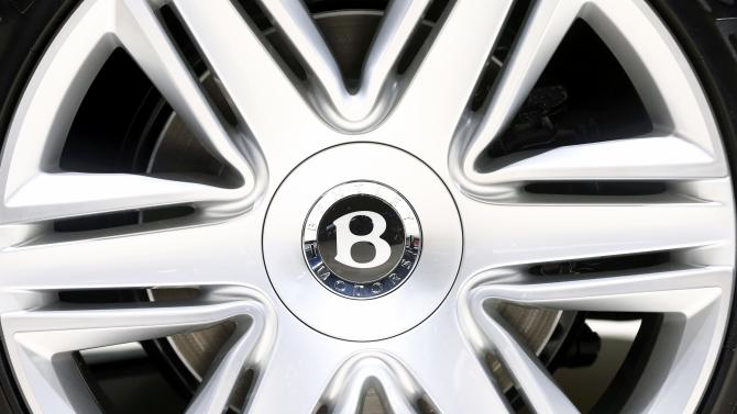 The wheel hub of a Bentley Continental GT convertible car is seen during the second press day ahead of the 85th International Motor Show in Geneva