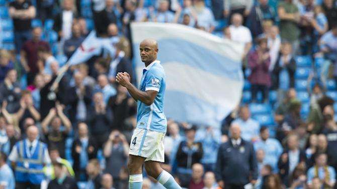 Manchester City's Vincent Kompany applauds supporters after the English Premier League soccer match between Manchester City and Watford at the Etihad Stadium, Manchester, England, Saturday Aug. 29, 2015. (AP Photo/Jon Super)