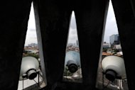 "Loudspeakers on the minaret of a mosque in central Jakarta used to broadcast prayers and announcements, seen in 2010. Most urban dwellers in the world's largest Muslim nation, which boasts 800,000 mosques, must contend with the ""azan"" that begins at dawn and calls worshippers to prayer five times a day"