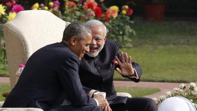 U.S. President Obama and India's PM Modi talk as they have coffee and tea together in the gardens at Hyderabad House in New Delhi