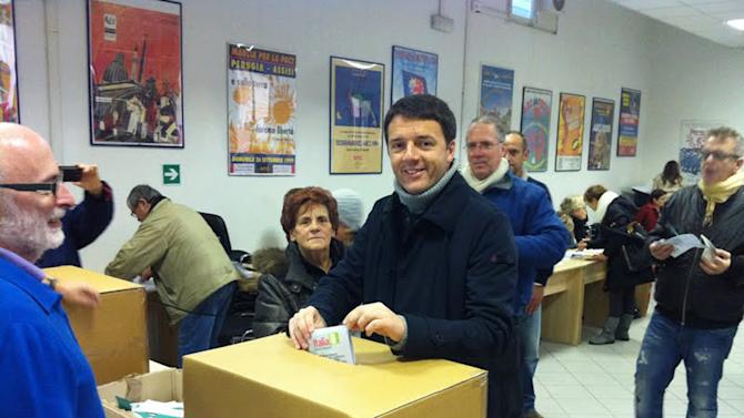 """In this picture made available by Matteo Renzi election committee, Florence's Mayor Matteo Renzi casts his vote during a primary runoff, in Florence, Italy, Sunday, Dec. 2, 2012. Italians are choosing a center-left candidate for premier for elections early next year, an important primary runoff given the main party is ahead in the polls against a center-right camp in utter chaos over whether Silvio Berlusconi will run again. Sunday's runoff pits veteran center-left leader Pier Luigi Bersani, 61, against the 37-year-old mayor of Florence, Matteo Renzi, not shown, who has campaigned on an Obama-style """"Let's change Italy now"""" mantra. (AP Photo/Matteo Renzi's election committee)"""