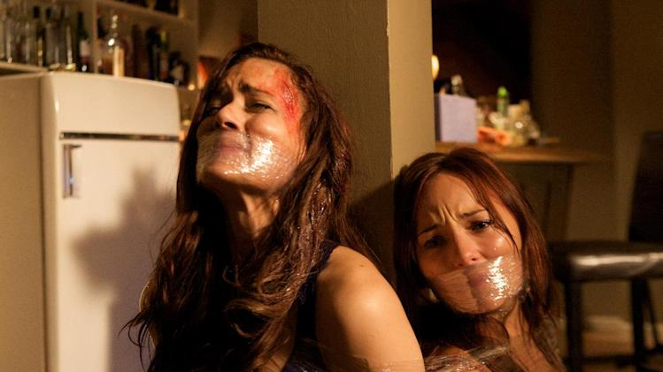 "In this film image released by Anchor Bay Films, Briana Evigan, left, and Deborah Ann Woll are shown in a scene from ""Mother's Day."" (AP Photo/Anchor Bay Films, Rebecca Sandaluk)"