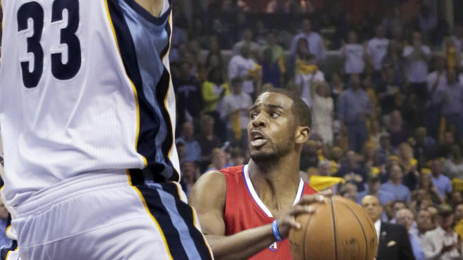Los Angeles Clippers' Chris Paul (3) looks for room around Memphis Grizzlies' Marc Gasol (33), of Spain, during the first half of Game 4 in a first-round NBA basketball playoff series in Memphis, Tenn., Saturday, April 27, 2013. (AP Photo/Danny Johnston)