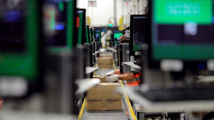 Amazon posts lower 4Q net income but stock jumps