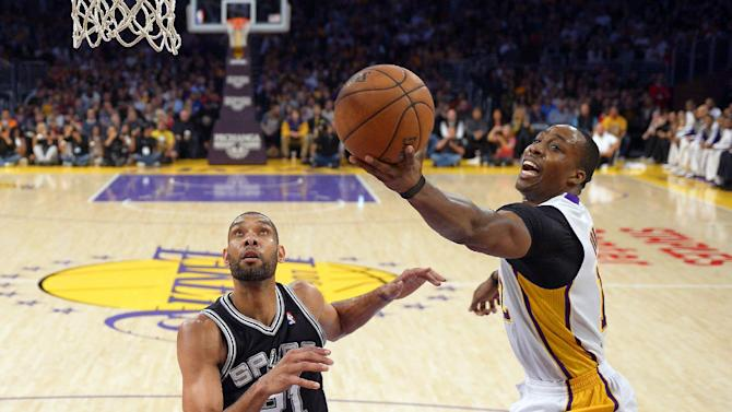 Los Angeles Lakers center Dwight Howard, right, shoots as San Antonio Spurs forward Tim Duncan defends during the first half of their NBA basketball game, Sunday, April 14, 2013, in Los Angeles. (AP Photo/Mark J. Terrill)