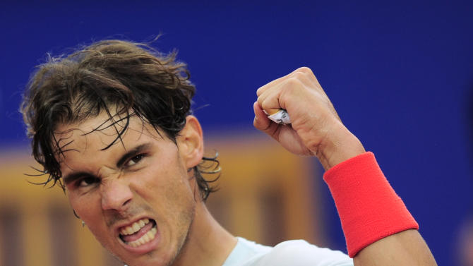 Rafael Nadal celebrates his victory over Albert Ramos during the Barcelona open tennis in Barcelona, Spain, Friday, April 26, 2013. Nadal won 6-3, 6-0. (AP Photo/Manu Fernandez)