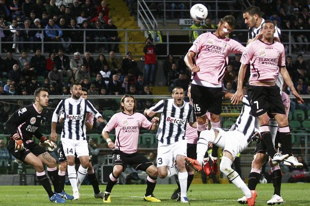 Juventus' Bonucci heads ball to score against Palermo during his Italian Serie A soccer match at Renzo Barbero stadium in Palermo