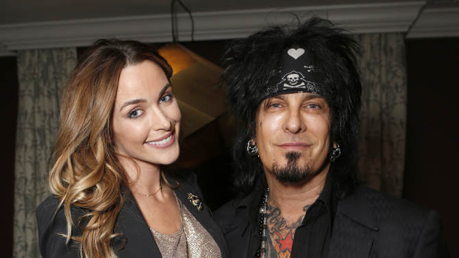 IMAGE DISTRIBUTED FOR HOUSE OF ROCK - Courtney Bingham and Nikki Sixx attend the 98.7 Saves Christmas Party at The House of Rock on Wednesday, Dec. 5, 2012, in Los Angeles, Calif. (Photo by Todd Williamson/Invision for House of Rock/AP)