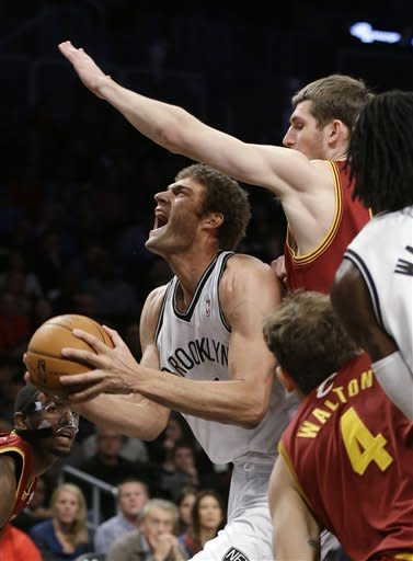 Nets hold off Cavs, move to 2-0 under Carlesimo