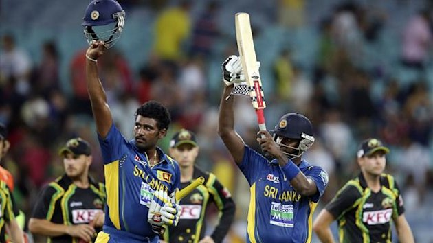 Sri Lanka's Angelo Mathews and Thisara Perera (L) acknowledge their supporters in the crowd after winning their Twenty/20 international cricket match against Australia at the Sydney Cricket Ground at Homebush in Sydney January 26, 2013.
