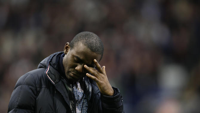 Bolton's Fabrice Muamba wipes tears from his eyes as he returns to The Reebok Stadium before his team's English Premier League soccer match against Tottenham, in Bolton, England, Wednesday, May 2, 2012. The 24-year-old has made a remarkable recovery since collapsing during the FA Cup tie between the same two teams at White Hart Lane on March 17. (AP Photo/Jon Super)