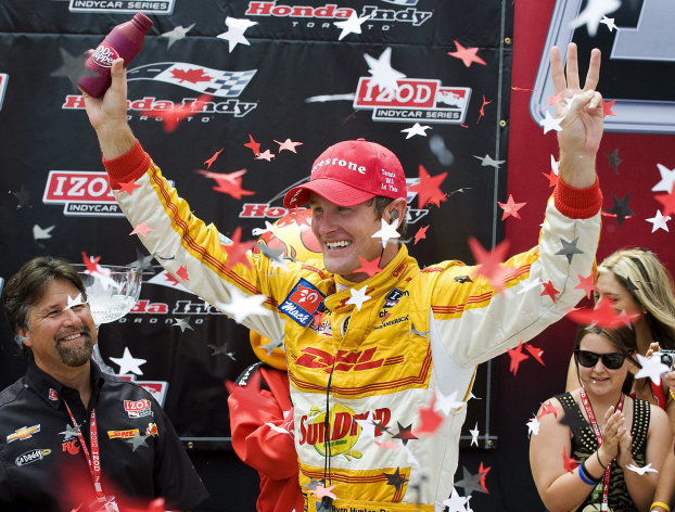 Ryan Hunter-Reay celebrates after winning the IndyCar Series Honda Indy Toronto auto race, Sunday, July 8, 2012, in Toronto. (AP Photo/The Canadian Press, Aaron Vincent Elkaim)