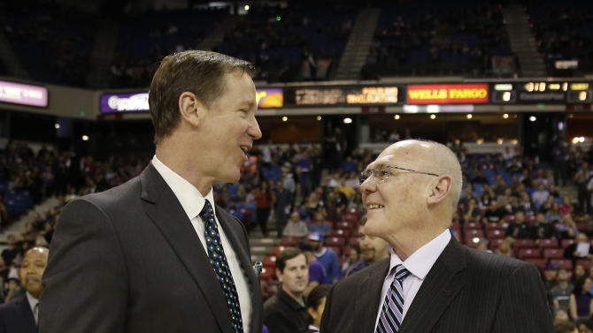 Portland Trail Blazers head coach Terry Stotts, left, talks with Sacramento Kings head coach George Karl before their NBA basketball game in Sacramento, Calif., Sunday, March 1, 2015. (AP Photo/Rich Pedroncelli)