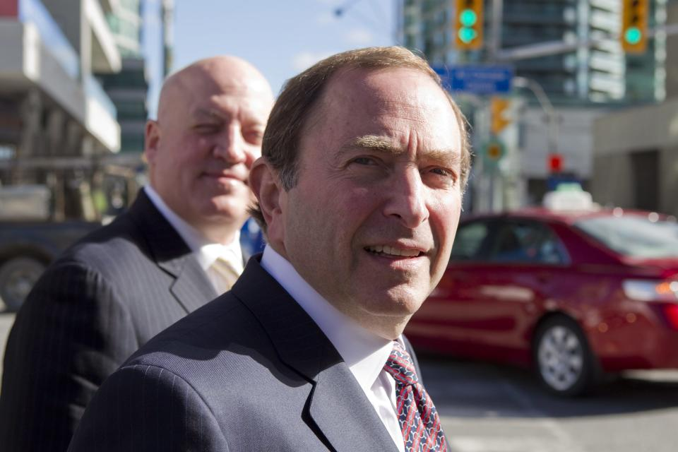 NHL commissioner Gary Bettman, foreground, arrives with deputy commissioner Bill Daly as the NHL and its locked-out player resume negotiations in Toronto on Wednesday Oct. 16, 2012. (AP Photo/The Canadian Press, Chris Young)