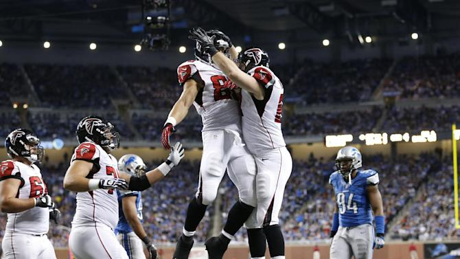 Atlanta Falcons tight end Michael Palmer, center right, celebrates his touchdown with tight end Tony Gonzalezduring the fourth quarter of an NFL football game against the Detroit Lions at Ford Field in Detroit, Saturday, Dec. 22, 2012. (AP Photo/Rick Osentoski)
