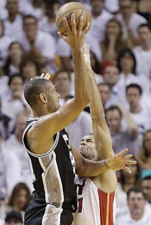 San Antonio Spurs power forward Tim Duncan (21) shoots under pressure from Miami Heat small forward Shane Battier (31) during the first half of Game 6 of the NBA Finals basketball game, Tuesday, June 18, 2013 in Miami. (AP Photo/Lynne Sladky)