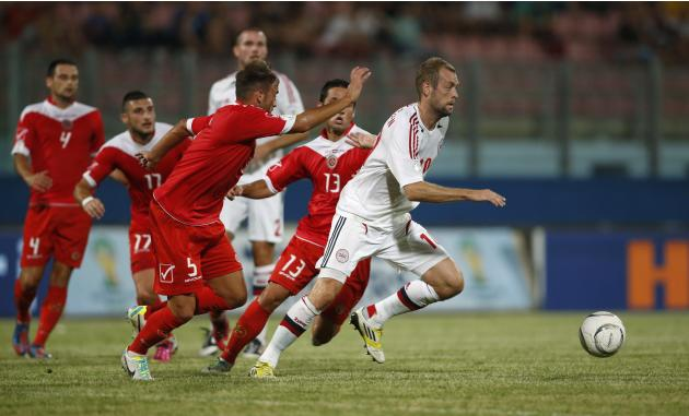 Denmark's Pedersen evades Malta's Agius and Schembri during their World Cup qualifying soccer match in Ta' Qali