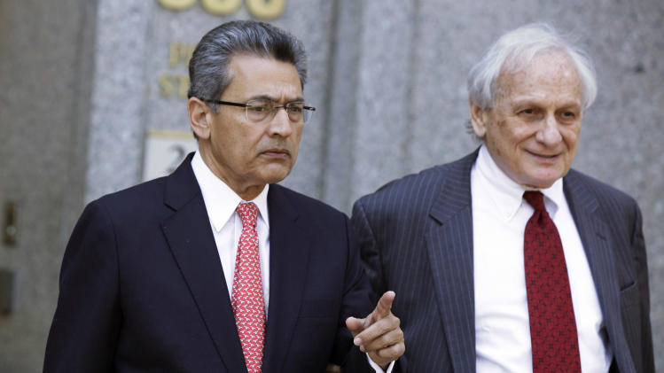 Former Goldman Sachs director Rajat Gupta, left, and his attorney Gary P. Naftalis, leave federal court in New York, Friday, June 15, 2012. Gupta, accused of feeding confidential information to a corrupt hedge fund manager, has been convicted of conspiracy and three counts of securities fraud. (AP Photo/Richard Drew)