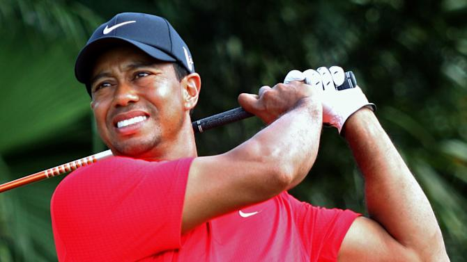 Tiger Woods hits off the 12th tee during the final round of the Cadillac Championship golf tournament on Sunday, March 11, 2012 in Doral, Fla. Woods then withdrew from the tournament. (AP Photo/Wilfredo Lee)